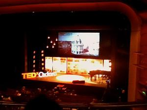 Stage of TedxOxford- Ideas Worth Spreading, an event with speakers, and videos from around the world