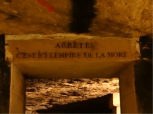 The entrance into the tomb area of the catacombs, underground in Paris