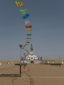 A view of a monastery museum and prayer flags.