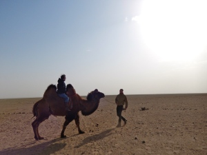 This is me riding a camel with Kit leading me. To put the size of the camel into perspective, Kit is over 6 feet tall.