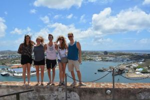 A few of us pose for a picture with the capital city of Curaçao behind us.