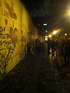 Less than 24 hours after the Wall had been erased, dozens of people helped start the process of establishing a new Lennon Wall.
