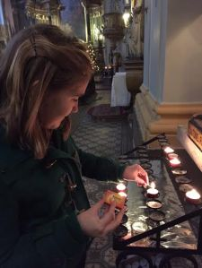Lighting candles at various Churches in Budapest to give thanks for my family and friends.