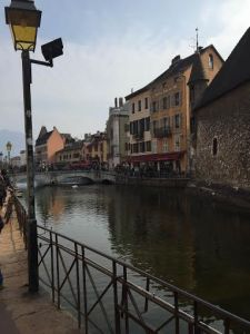 [Picture of the city] Caption: Annecy felt like the perfect historic little town, each building had its own character.