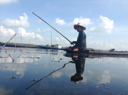In an area affected by a dam construction, this man now fishes where homes used to be.