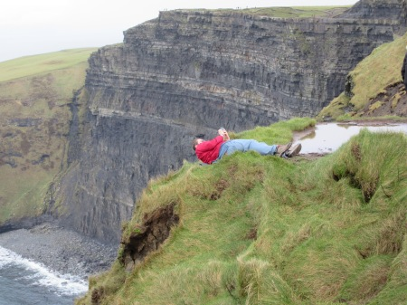 Caption: And here we see my friend Murphy leaning off the top of the 400ft cliffs for some reason that he couldn't seem to provide.