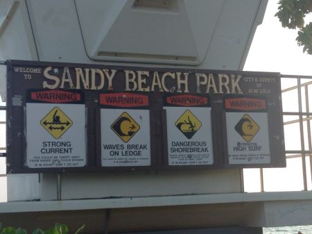 Surf advisories at Sandy Beach