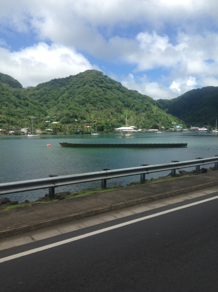 A traditional canoe by Tutuila's main road. April 17th is Flag Day for American Samoa, and each village will have a canoe in an island-wide boat race in the main harbor